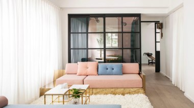 The core living space composed of the living ceiling, couch, furniture, home, interior design, living room, real estate, room, wall, window, white