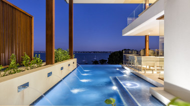 An infinity pool and entry pond in this apartment, architecture, building, condominium, design, estate, home, house, interior design, property, real estate, residential area, resort, roof, room, swimming pool, villa, white, blue