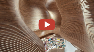 Museum of Qatar video button - brown brown