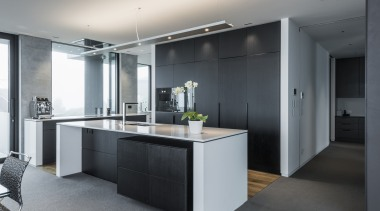 Bold and sculptural with no fussy detailing, this architecture, cabinetry, countertop, cuisine classique, interior design, kitchen, gray, black