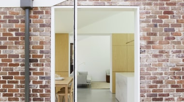 A contemporary pivot door is set into a architecture, daylighting, door, facade, house, real estate, wall, window, white