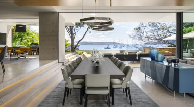 ​​​​​​​Stairs rather than walls delineate the raised kitchen architecture, dining room, interior design, dining table, furniture, timber floor,  SAOTA, travertine