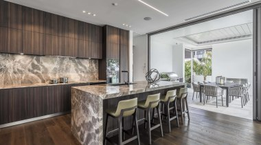 ​​​​​​​While the LED strip ceiling lighting is understated architecture, cabinetry, countertop, benthtop, design, dining room, floor, flooring, furniture, hardwood, home, house, interior design, kitchen, dining table, wood flooring, marble, Studio Italia