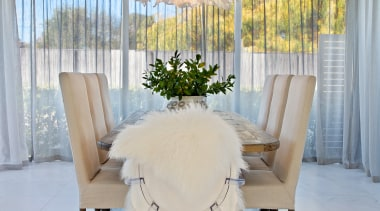 ​​​​​​​This formal dining room steps down from the chair, curtain, floor, flooring, furniture, home, house, interior design, table, textile, white, yellow, formal dining, O'Neil Architecture, Fandango lighting pendant, Hive
