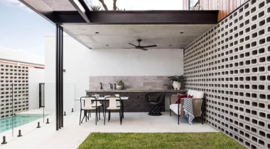 ​​​​​​​This alfresco dining area features materials such as architecture, alfrsco dining, design, furniture, home, house, interior design
