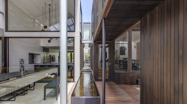 ​​​​​​​While the water running between the two wings home, architecture, courtyard, facade, home, house, interior design, two wing home, CplusC Architectural Workshop