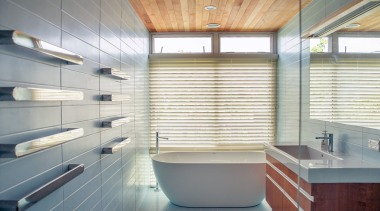 ​​​​​​​Clean-lined, aesthetically enduring and highly functional, this general architecture, bathroom, bathtub, floor, flooring, home, house, interior design, plumbing fixture, tile, toilet, blue, Frans Kamermans, Kamermans Architects