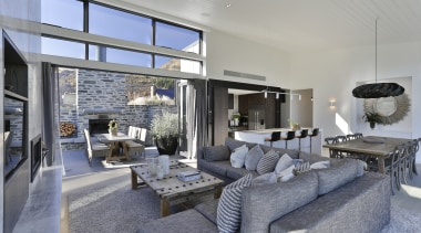 Despite its modest footprint, this spacious, modern home House, architecture, design, floor, furniture, home, house, interior design, living room, table, gray, Koia Architects