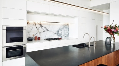 ​​​​​​​With this kitchen's perimeter cabinetry in white, the building, cabinetry, ceiling, countertop, floor, flooring, furniture, home, home appliance, house, interior design, kitchen, kitchen appliance, kitchen stove, material property, property, room, small appliance, table, tile, white
