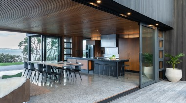 Context is everything. This kitchen connects with and architecture, backyard, building, ceiling, deck, design, estate, floor, flooring, furniture, home, house, interior design, landscaping, patio, porch, property, real estate, roof, room, table, gray, black