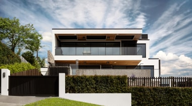 Interesting and varied window shapes, a facade that gray