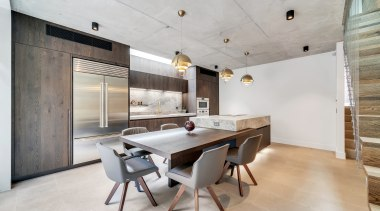 This material-rich kitchen by Thinkdzine features Italian smoked
