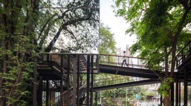 The glass structure blends into the trees architecture, condominium, plant, real estate, skyway, tree, walkway, black, white