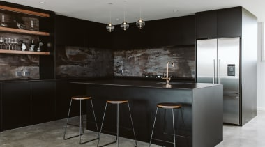 A distressed-look splashback and wood shelving punctuate the bar stool, black, building, cabinetry, ceiling, countertop, cupboard, design, dining room, floor, flooring, furniture, home, house, interior design, kitchen, kitchen stove, material property, property, room, table, black, gray