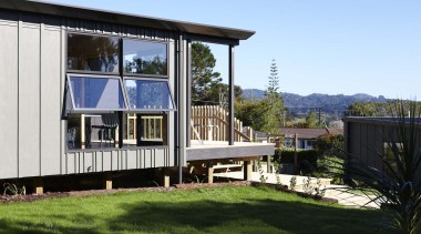 Waitakere Ranges - Studio 19 VisionWest Community Housing architecture, cottage, facade, home, house, property, real estate, teal, black