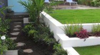 At Ellerslie International Flower Show - At Ellerslie backyard, garden, grass, landscape, landscaping, lawn, plant, property, real estate, shrub, walkway, yard, white, black