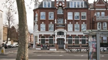 The South Fulham Conservative Club lies unoccupied close building, city, facade, home, house, mixed use, neighbourhood, property, residential area, street, town, window, gray, white