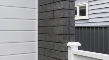 Simpler. Faster. Proven Weathertight.For more information, please visit brick, brickwork, facade, home, house, roof, siding, stone wall, wall, window, wood stain, gray, black