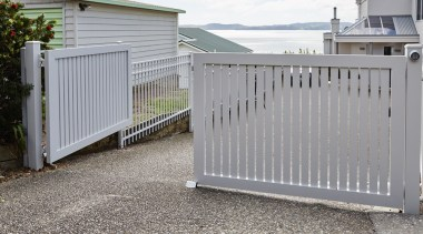 Aluminium slat gates were also installed, finished in fence, gate, home fencing, outdoor structure, picket fence, real estate, gray
