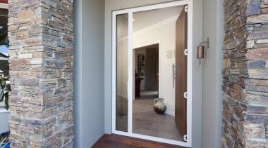 Schist pillars define the entrance to this Taranaki brick, door, estate, floor, flooring, home, property, real estate, wall, window, gray