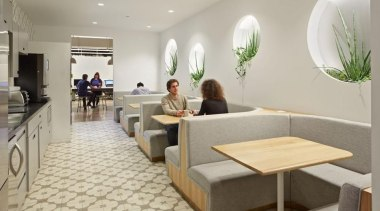 The design for renowned advertising agency Wieden+Kennedy moves furniture, interior design, lobby, gray