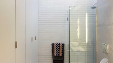 The shower is positioned beneath a skylight. - bathroom, ceiling, daylighting, interior design, plumbing fixture, room, tile, gray