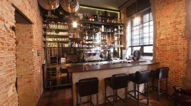 Dekton color Keranium - Dstage - barra entrada bar, café, interior design, restaurant, brown