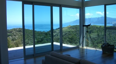Bush and sea views. - Amodea Bay - apartment, condominium, daylighting, door, glass, home, interior design, penthouse apartment, property, real estate, sky, window, black, teal
