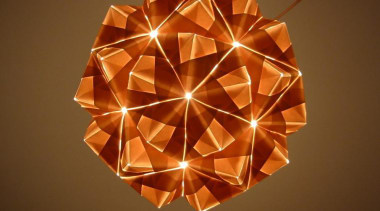 A range of folded metallic fabrics  are lampshade, light fixture, lighting, lighting accessory, origami, symmetry, brown