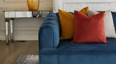 Plush, a sumptuous velvet-look polyester brings together old bed, chair, couch, cushion, floor, flooring, furniture, hardwood, home, interior design, living room, loveseat, orange, room, sofa bed, studio couch, table, wood, gray