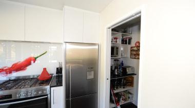 Kitchen design features red hot chilli splash back. interior design, room, white