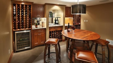 Because of its expansive and wide-open layout, a cabinetry, countertop, dining room, furniture, interior design, kitchen, room, brown