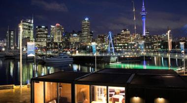 Samsung Electronics New Zealand has revealed its Home city, cityscape, downtown, marina, metropolis, metropolitan area, night, reflection, sky, skyline, skyscraper, tourist attraction, tower block, water, black, blue