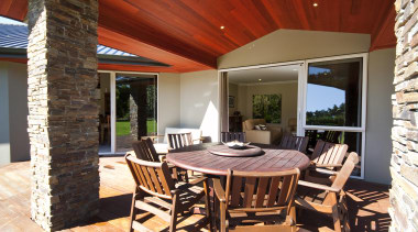 Pitched roof lined with cedar covers this outdoor dining room, estate, interior design, patio, property, real estate