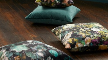 Flowerbomb features a majestic, ethereal bouquet of peonies, cushion, furniture, textile, black