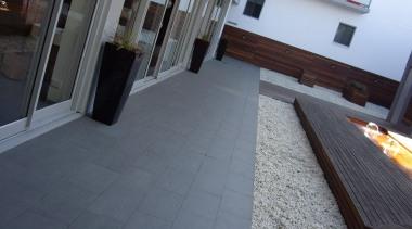 Gem grey exterior patio tiles - RAK Gem apartment, floor, flooring, hardwood, house, laminate flooring, property, real estate, roof, tile, window, wood flooring, gray, black