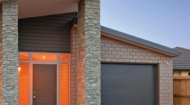 The Designa Schist column system makes it so brick, elevation, estate, facade, garage door, home, house, property, real estate, siding, gray, blue