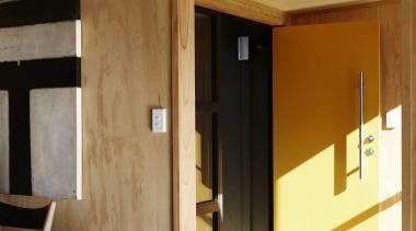 Waitakere Ranges - Studio 19 VisionWest Community Housing architecture, door, floor, home, house, interior design, wall, wood, brown