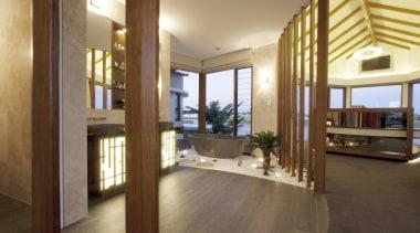 Winner Bathroom of the Year Queensland 2013 by estate, floor, flooring, hardwood, interior design, laminate flooring, living room, lobby, property, real estate, suite, window, wood, wood flooring, brown