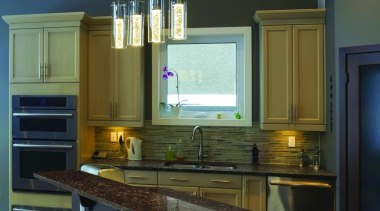 Earth and fire is represented in the color cabinetry, countertop, interior design, kitchen, room, under cabinet lighting, black, brown