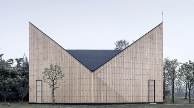 This wood and steel structured chapel has gentle architecture, building, corporate headquarters, facade, white, gray