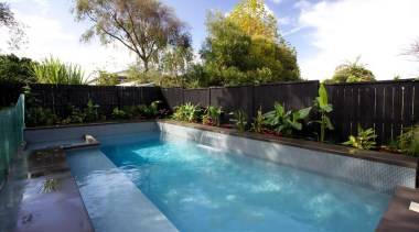 Gold Award recipient for Residential Swimming Pools over backyard, estate, fence, home, house, landscaping, leisure, outdoor structure, property, real estate, resort, swimming pool, villa, water, yard, teal