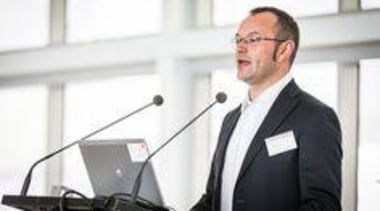 Matteo Messorri from Laminam Italy, speaking at the business, business executive, communication, microphone, profession, professional, public speaking, technology, white