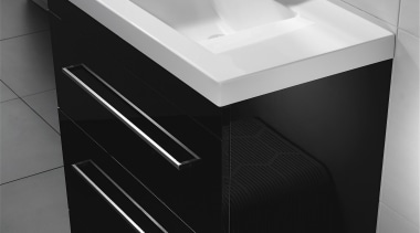 Squared external edges paired with a sweeping basin angle, bathroom, bathroom accessory, bathroom cabinet, bathroom sink, black, countertop, drawer, furniture, plumbing fixture, product, product design, sink, tap, black, gray