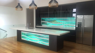 Colourful glass splashbacks create a dynamic backdrop in floor, flooring, furniture, glass, interior design, table, gray, black