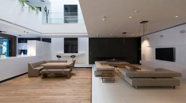 The Sharifi-ha House in Tehran can adapt to architecture, ceiling, daylighting, floor, flooring, hardwood, house, interior design, living room, property, real estate, wood flooring, gray