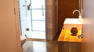 Downstairs the new oak vanity contrasts the existing bathroom, cabinetry, countertop, floor, flooring, hardwood, home, house, interior design, kitchen, laminate flooring, real estate, room, sink, tile, wall, wood, wood flooring, brown