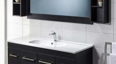 A subtle slim line profile and softly rounded bathroom, bathroom accessory, bathroom cabinet, chest of drawers, furniture, plumbing fixture, product, product design, sink, white, black, gray