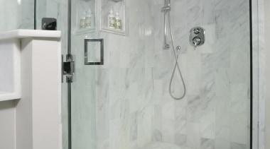 We reconfigured this Master Bathroom to be a bathroom, floor, interior design, plumbing fixture, property, room, shower, tile, wall, gray