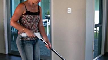 Jen Vacuuming - Jen Vacuuming - floor | floor, flooring, fun, girl, house, leg, shoulder, standing, black, gray